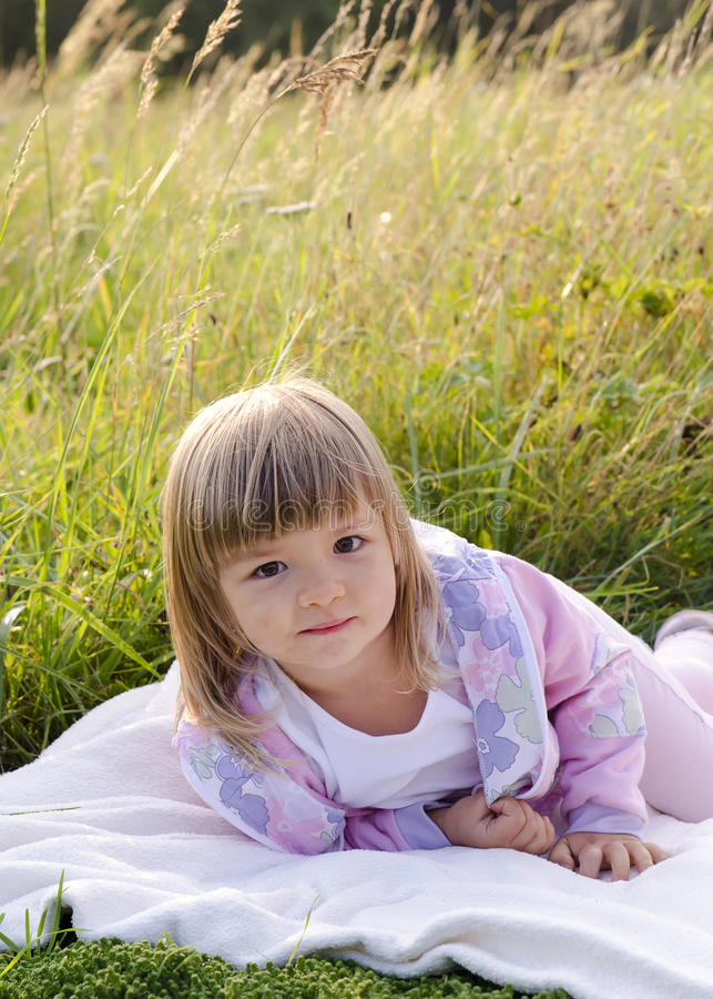 Child in long grass stock photos