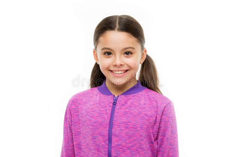 Child long hair happy smiling. Happy childhood concept. What is difference between phony and sincere smile. Girl cute. Child happy smiling face. What science royalty free stock photo