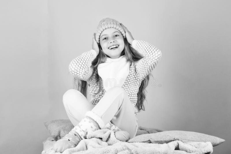 Child long hair warm woolen hat enjoy warm. Warm clothes concept. Warm accessories that will keep you cozy this winter royalty free stock photography