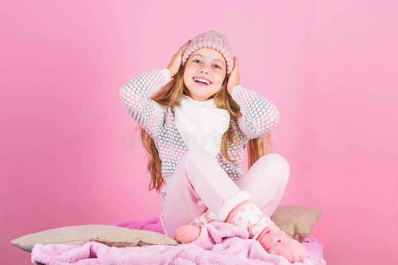 Child long hair warm woolen hat enjoy warm. Warm clothes concept. Warm accessories that will keep you cozy this winter stock photo