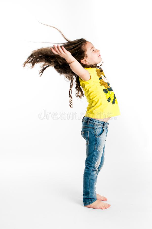 Child with long hair in the wind stock photography