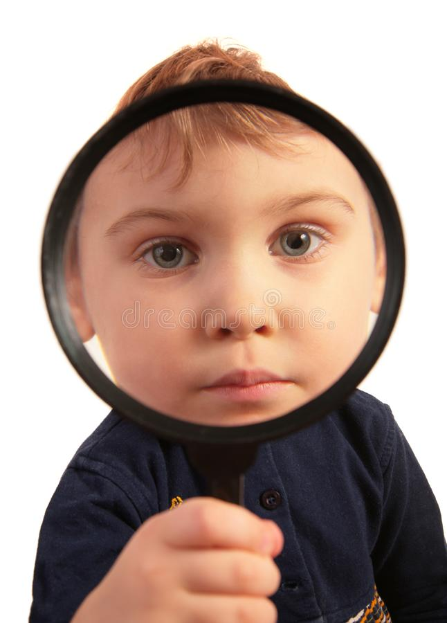 Child look through magnifier royalty free stock image