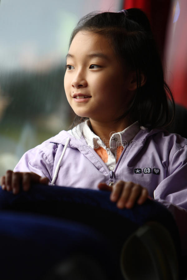 Child look outside on bus