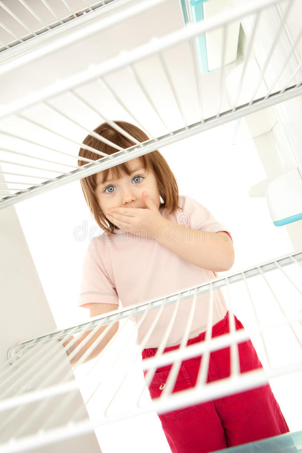 Download Child Looking In Empty Fridge Stock Photo - Image: 18849776