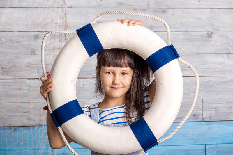 Child looking through a lifeline royalty free stock photo