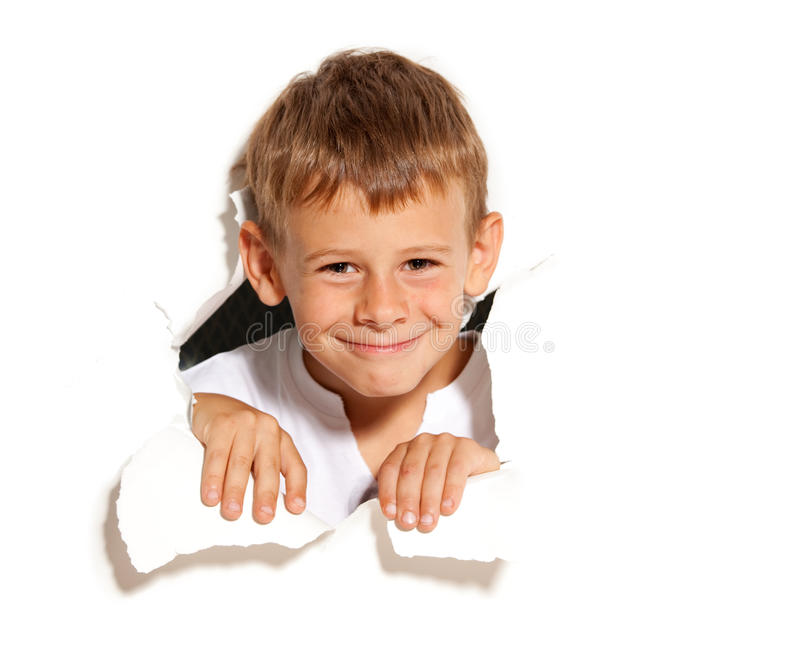 Child looking out of a hole. Happy boy royalty free stock photos