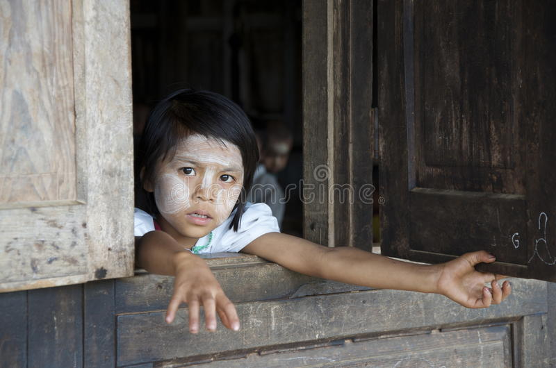 Child looking out the window of school stock photos
