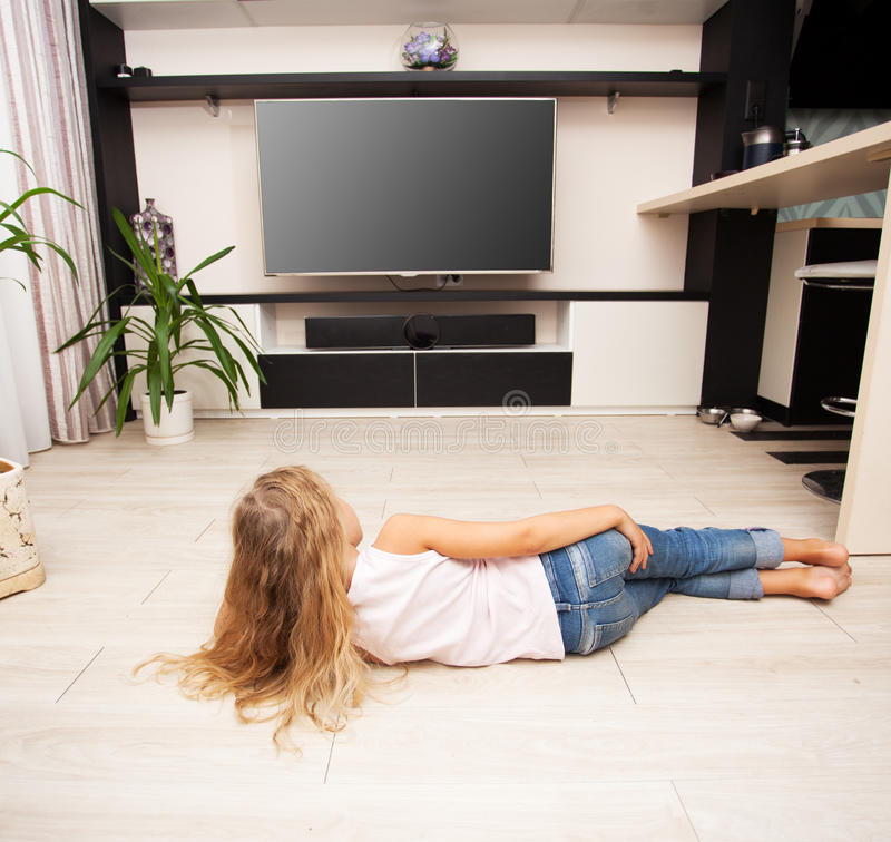 Child looking at television royalty free stock image