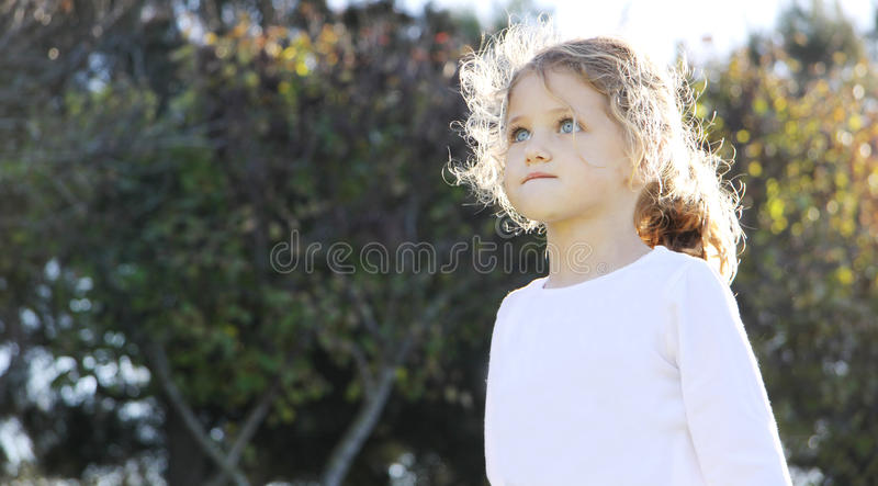 Child looking up stock photos
