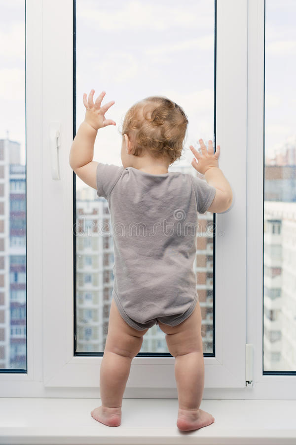 Child looking at window royalty free stock photos