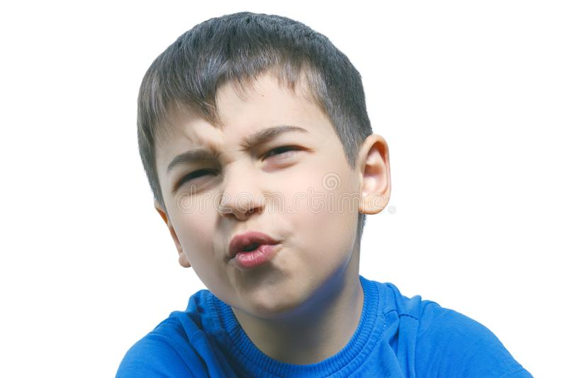 Child looks with disgust, something stinks, bad smell, isolated over white wall background with copyspace royalty free stock image