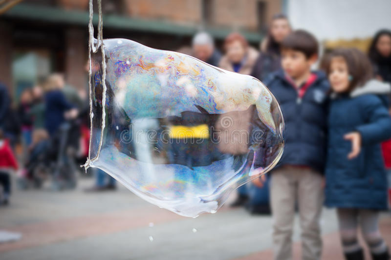 Child looks at a giant soap bubble royalty free stock photography