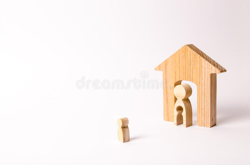 The child looks at his mother and his house before leaving. A mother with a void in the body in the form of a child is standing royalty free stock photo