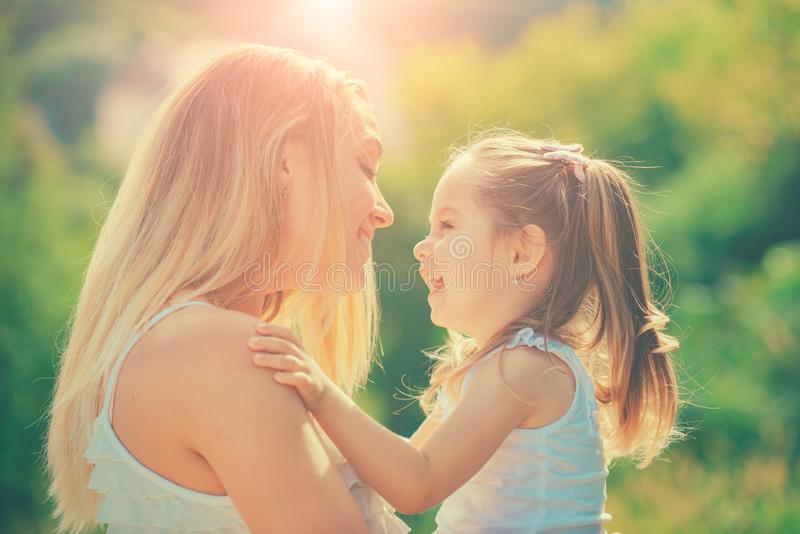 Child love. Close-up portrait of smiling mother hugging cute little daughter. Family and motherhood concept. Happy woman royalty free stock photo