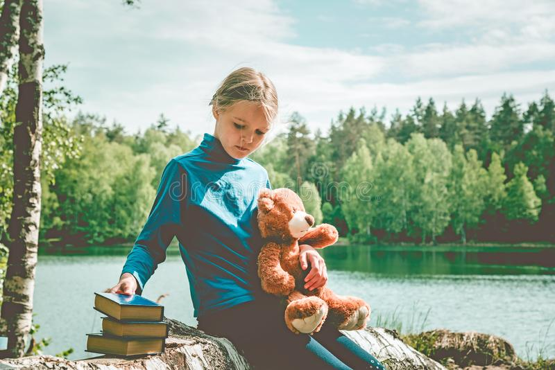 Child love Teddy Bear as their Best Friends read book. Best Friend Concept royalty free stock image
