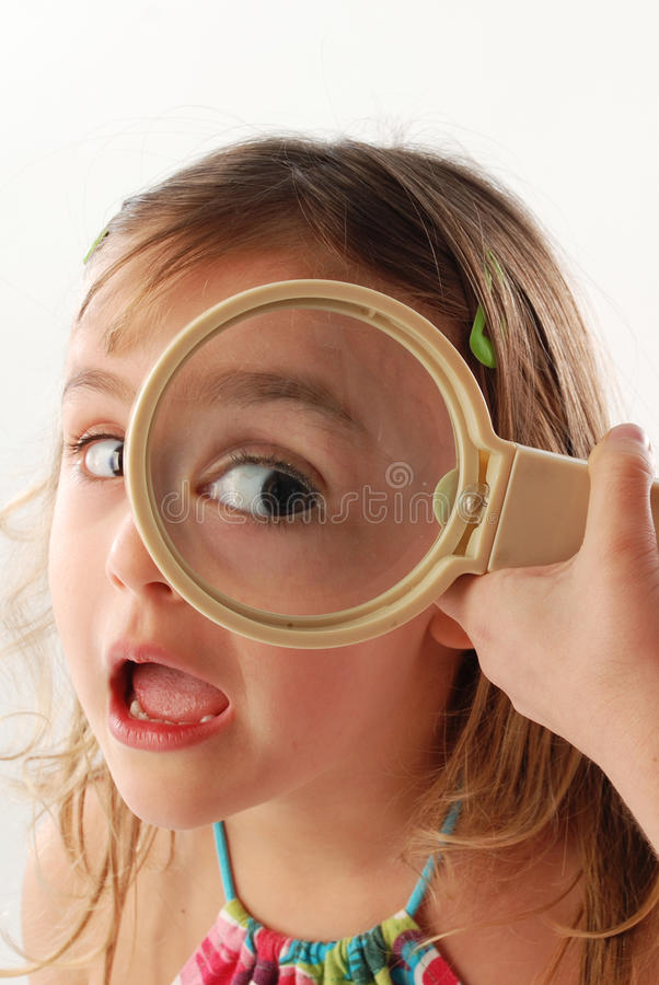 Child with magnifying glass stock photos