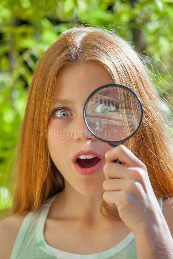 Child with magnifying glass royalty free stock photos