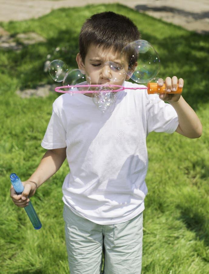 Child makes bubbles stock photos