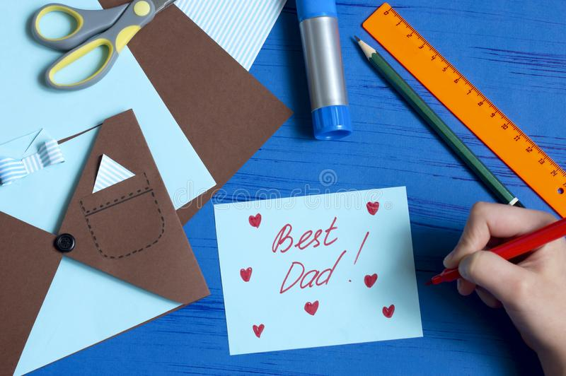 Child makes greeting card for Father`s Day. Step 11 stock images