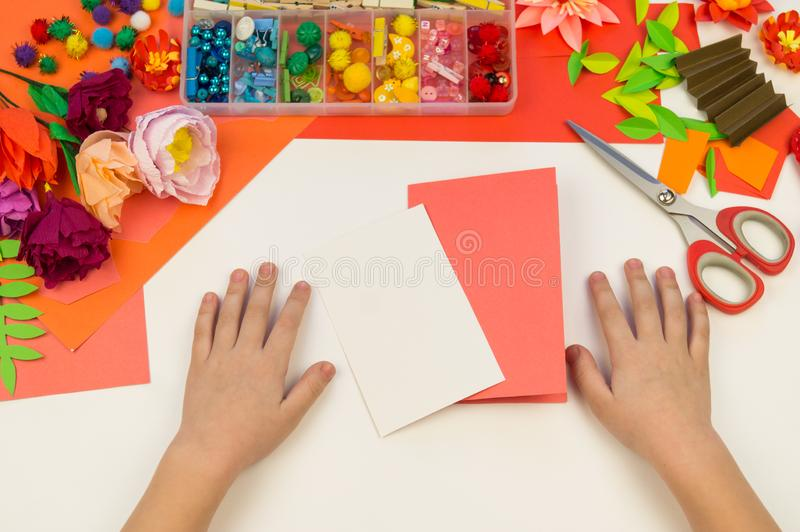 Child makes a postcard flat lay. Gift for mother a holiday on 8 March stock images