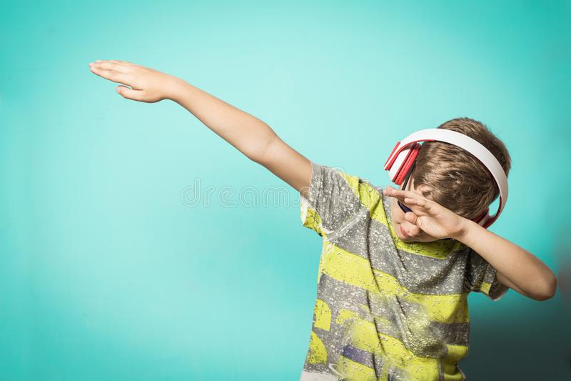 Child making Dab. Kid dancing dab royalty free stock images