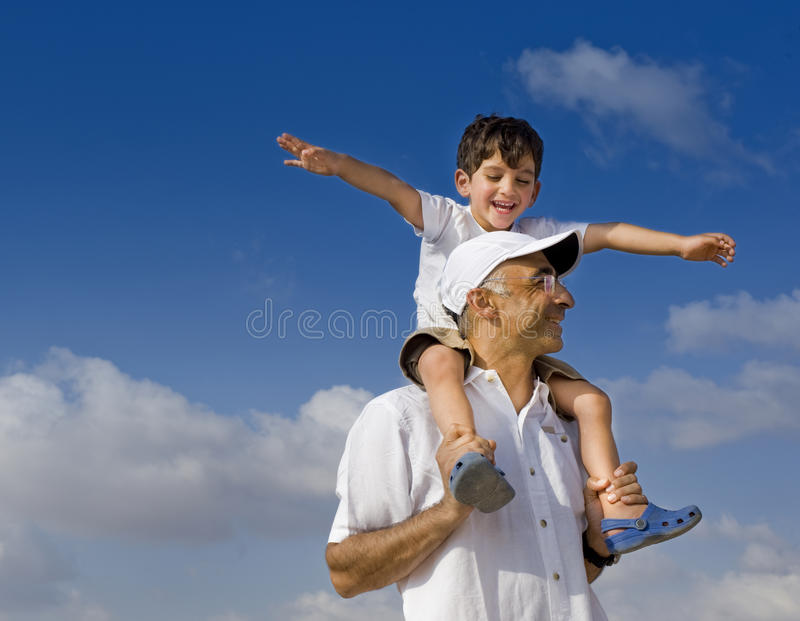 Download Child on man shoulders stock photo. Image of countryside - 11335342
