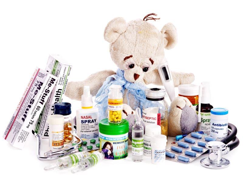 Child medicine and teddy bear.