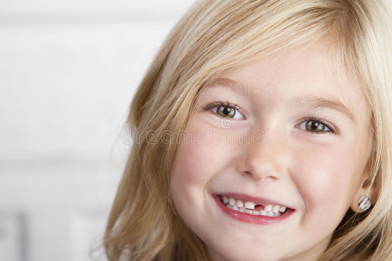 Child missing front tooth. Close up of child missing her top front tooth royalty free stock image