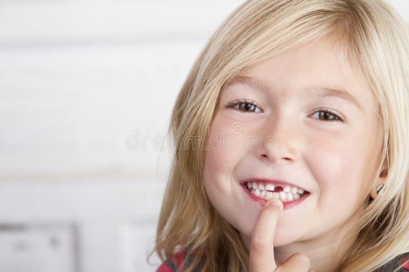 Child missing front tooth. Pointing at it with her finger stock images