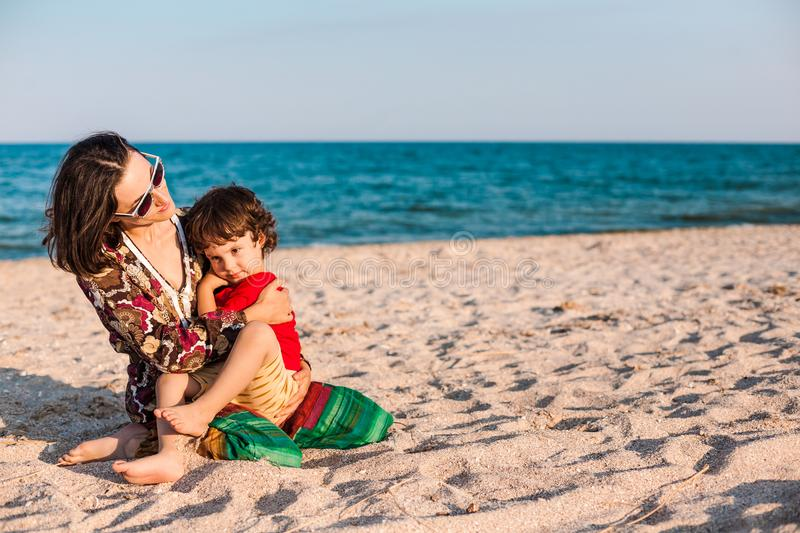 Child with mom on the beach. royalty free stock image