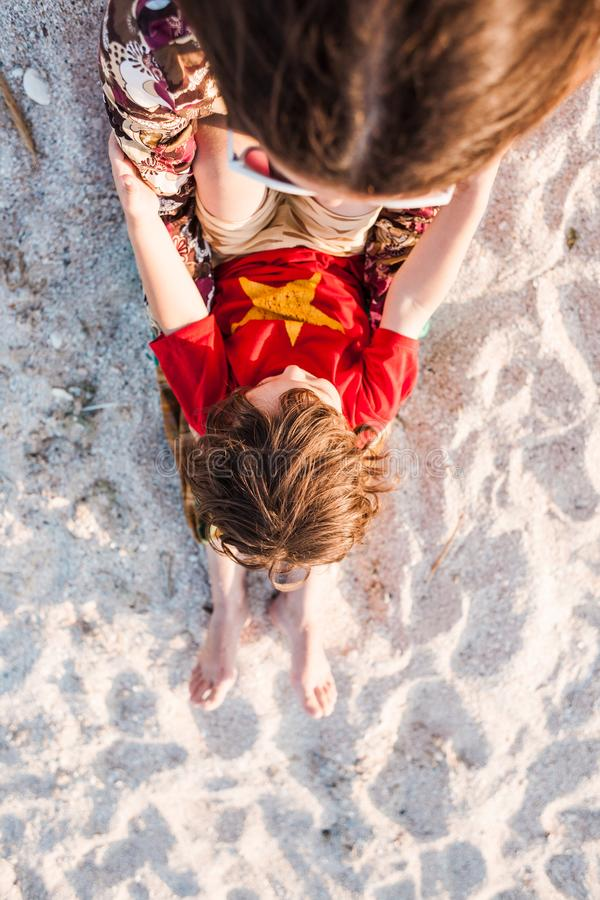 Child with mom on the beach. royalty free stock images