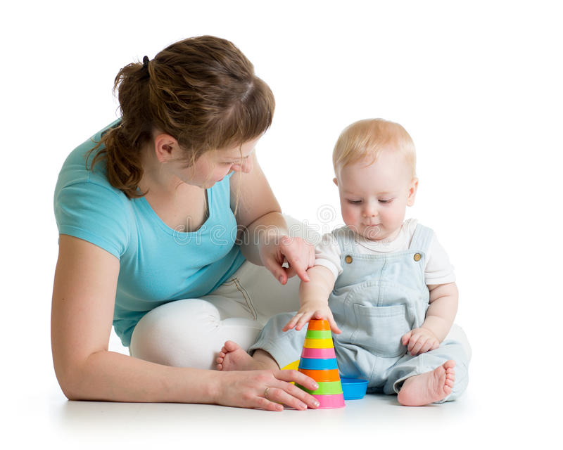 Child and mom play with block toys stock photography