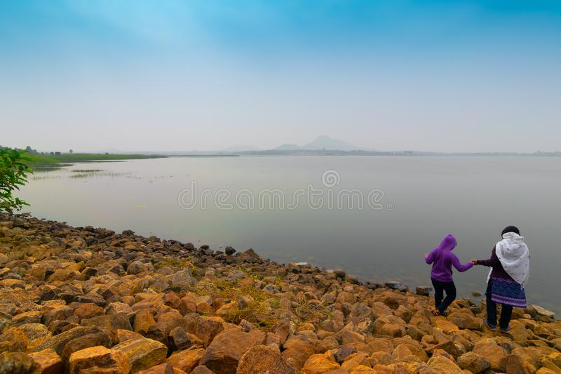Child and mother at Baranti dam, Purulia, west bengal, India royalty free stock photos