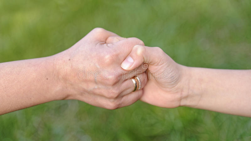 Child and mother holding hands royalty free stock photography