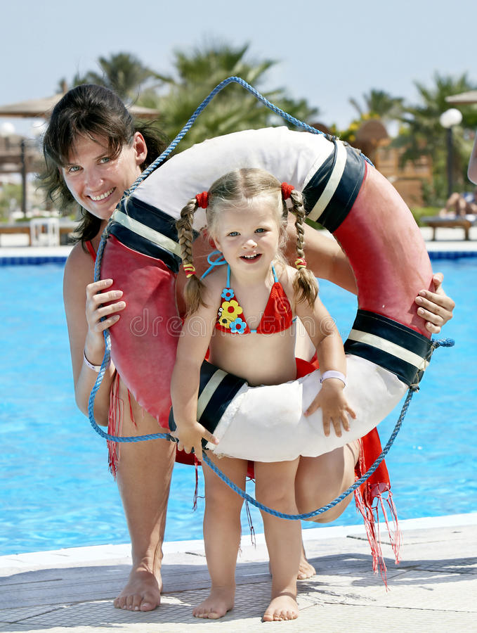 Download Child With Mother Near Swimming Pool. Stock Photo - Image: 18564212