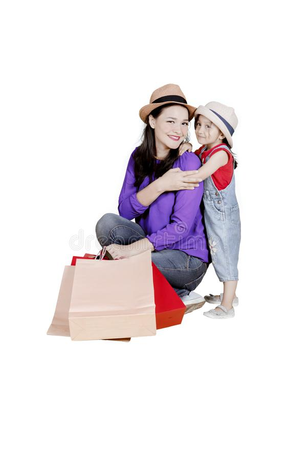 Child and mother with shopping bags on studio royalty free stock photo