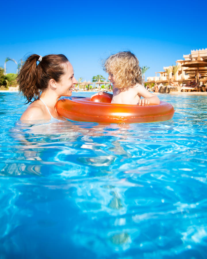Free Swimming Pool: Child With Mother In Swimming Pool Royalty Free Stock