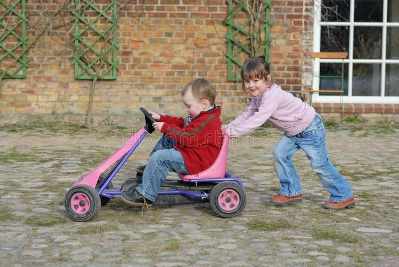 Child moves pedal car stock photos