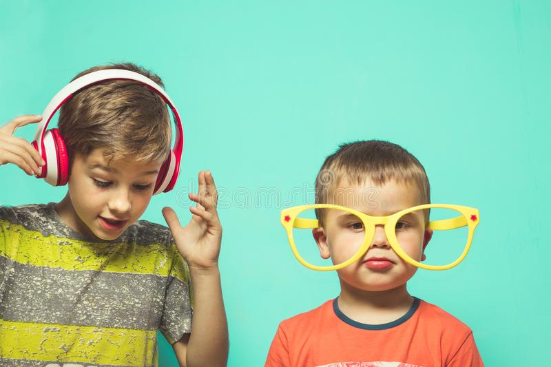 Child with music helmets and big glasses. Child with music helmets , funny picture of children royalty free stock image