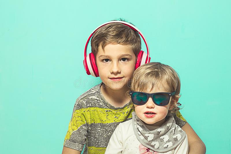 Child with music helmets and big glasses. Child with music helmets , funny picture of children royalty free stock images