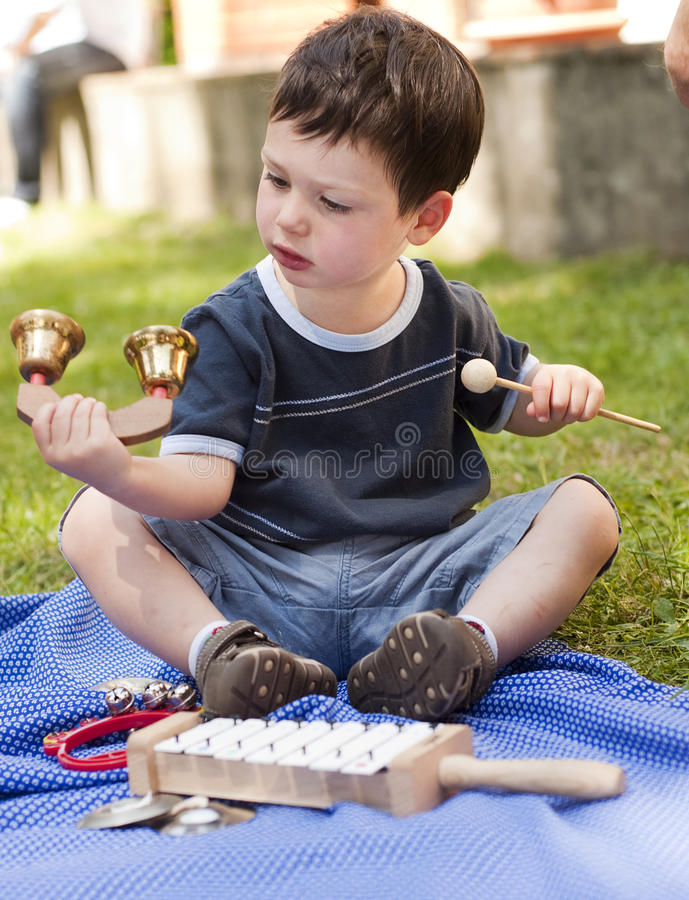 Download Child With Musical Instruments Stock Photo - Image of learn, green: 20202550