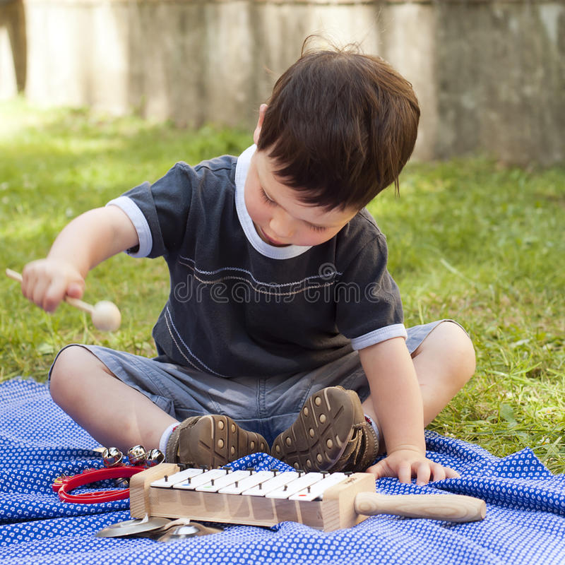Child with musical instruments royalty free stock photo