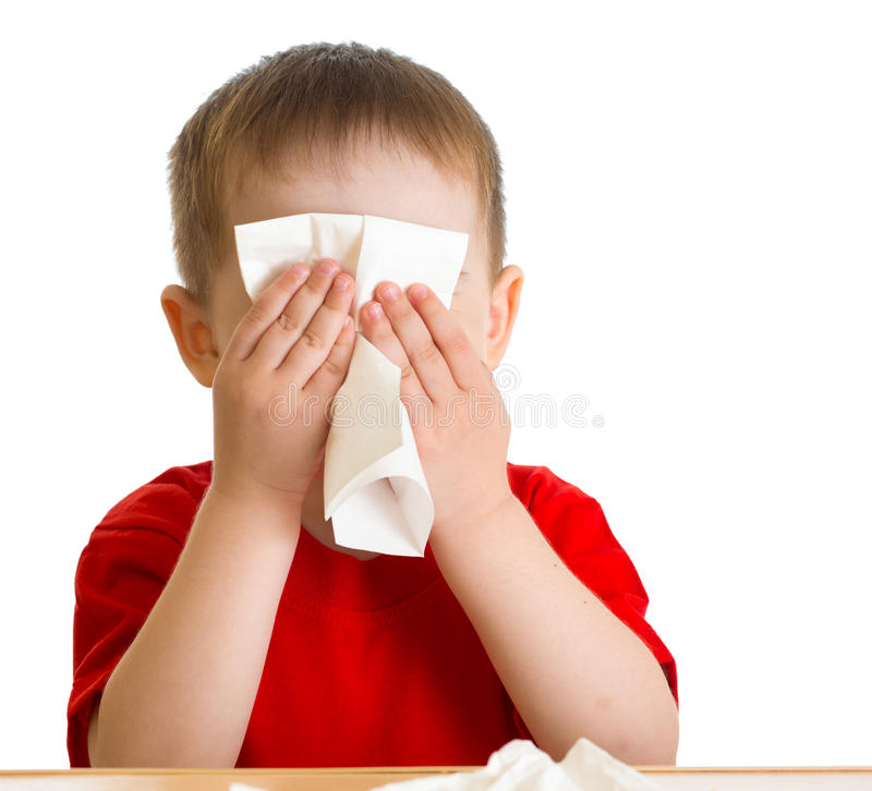 Child nose wiping with tissue royalty free stock photos
