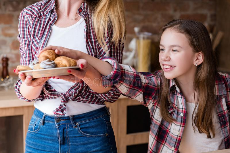 Child nutrition unhealthy habits pastry croissant. Child nutrition problems. unhealthy eating habits. pastry temptation. little girl is in love with croissants royalty free stock photo