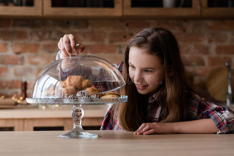 Child nutrition unhealthy habits pastry croissant. Child nutrition problems. unhealthy eating habits. pastry temptation. little girl is in love with croissants royalty free stock images