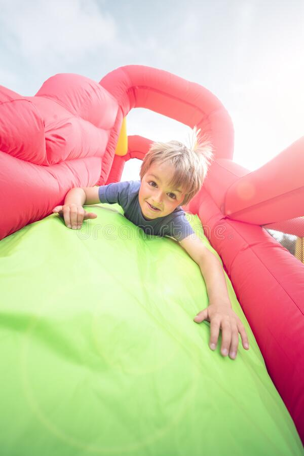 Free Child On Inflatable Bouncy Castle Slide Stock Photo - 218296000