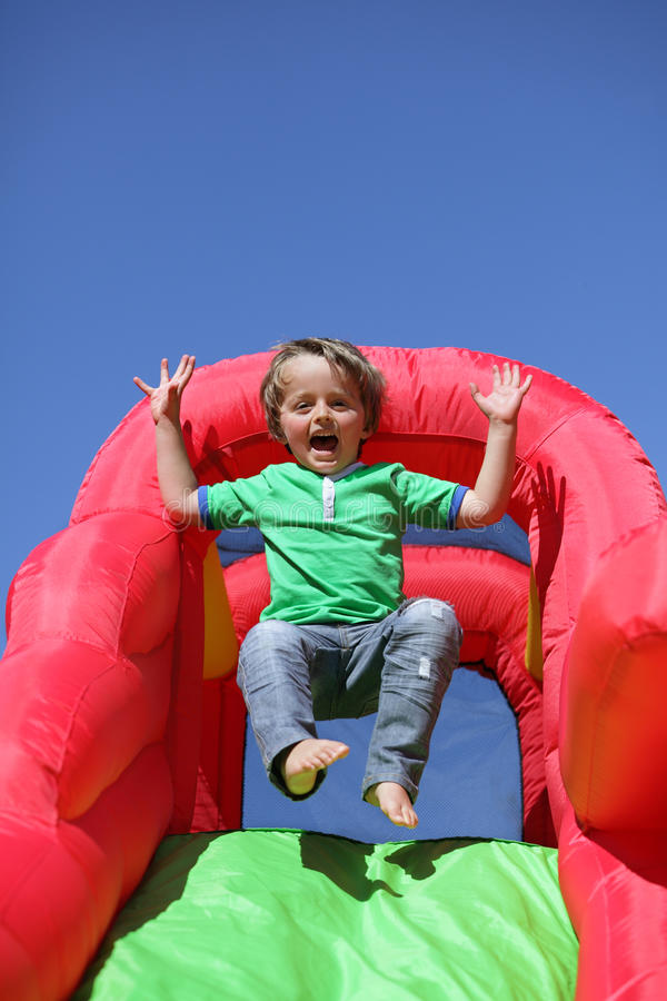 Free Child On Inflatable Bouncy Castle Slide Stock Photos - 30826943