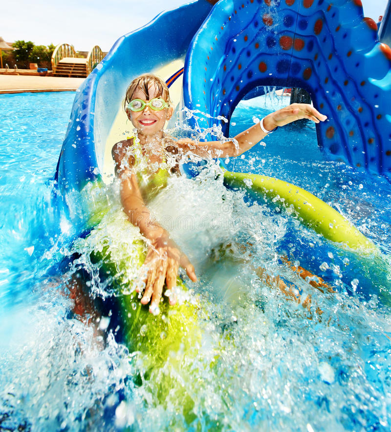 Free Child On Water Slide At Aquapark. Stock Photos - 22034783