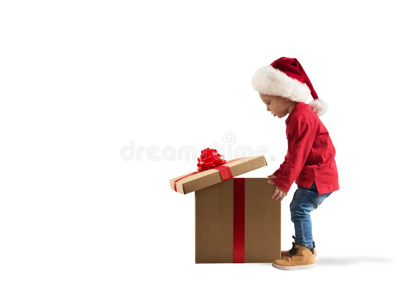 Child that open a magic Christmas gift. White background royalty free stock photography