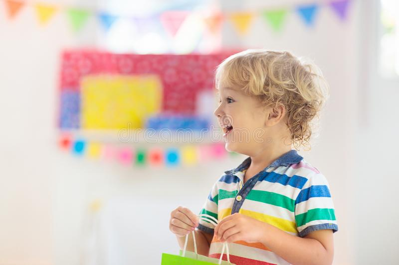 Child opening birthday present. Kid at party royalty free stock photography